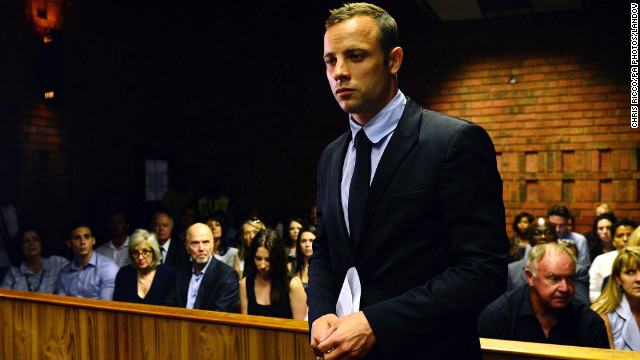 Image #: 21288575    Oscar Pistorius enters the court room during the second day of Oscar Pistorius bail application at Pretoria Magistrates Court, Pretoria, South Africa on 20 February 2013          PA PHOTOS /LANDOV