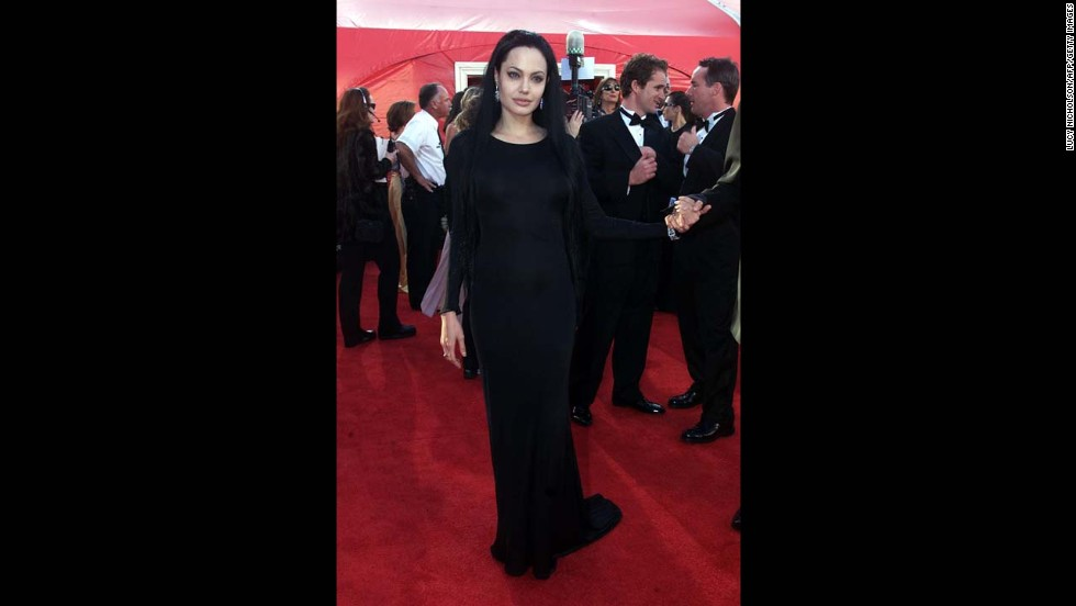 We get it: Angelina Jolie has a personal style. It often involves a lot of black -- and sometimes clingy -- fabrics. But even Morticia Addams would dress it up a bit when going to the Oscars. Especially if she was going to walk away with the best supporting actress award, as Jolie did in 2000.