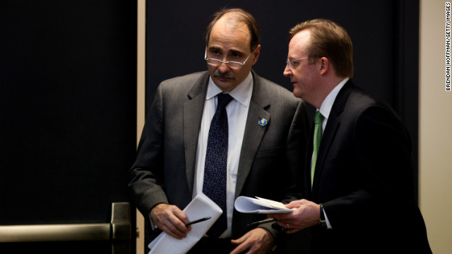 WASHINGTON, DC - DECEMBER 22: Senior Advisor David Axelrod talks with Press Secretary Robert Gibbs (R) while President Barack Obama holds a news conference at the Eisenhower Executive Office Building on December 22, 2010 in Washington, DC. Earlier in the day, the president signed into law a repeal of the Don't Ask Don't Tell provision and the Senate ratified the New Start nuclear arms treaty with Russia.
