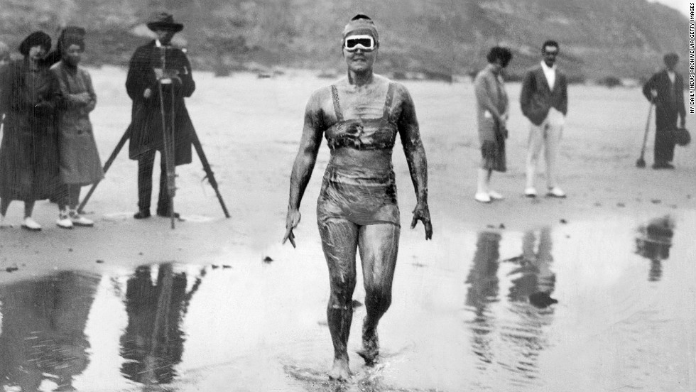 Gertrude Ederle wades into the water on her way to becoming the first woman to swim the English Channel, which she did in 14 hours and 31 minutes, breaking the previous men's record.
