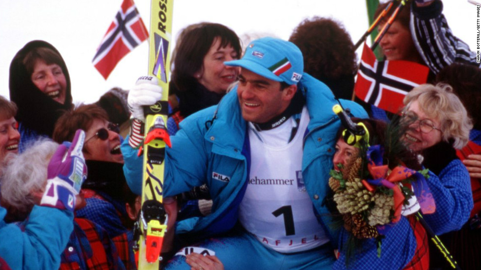 Tomba is mobbed by adoring fans after a sensational second leg saw him claim the slalom silver medal at the 1994 Winter Olympics in Lillehammer, Norway.