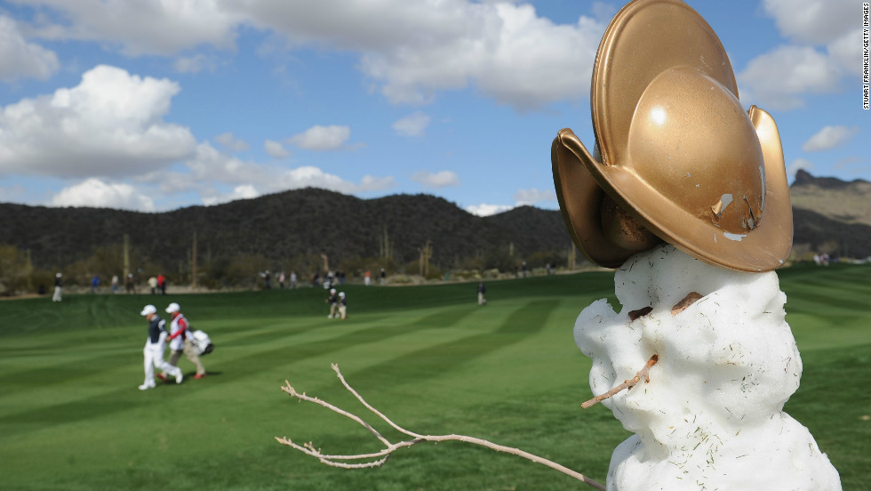 """Frosty the Snowman"" keeps cool while the players get back to work in Arizona. Frosty is modeling a new hat too."