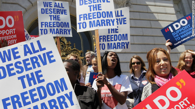 SAN FRANCISCO - AUGUST 12: Supporters of same-sex marriage hold signs and cheer after a stay was lifted that allows same-sex couples to marry in California August 12, 2010 in San Francisco, California. California Supreme court Judge Vaughn Walker lifted a stay on same-sex marriages in California just over one week after his ruling that Prop