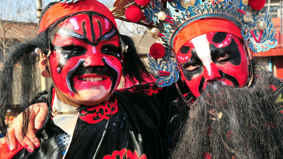 "Villagers in Chinese opera costumes celebrate during <a href=""http://travel.cnn.com/7-ways-celebrate-chinese-new-year-395376"">Chinese New Year</a> festivities in Xi'an, China, on Friday, February 22."