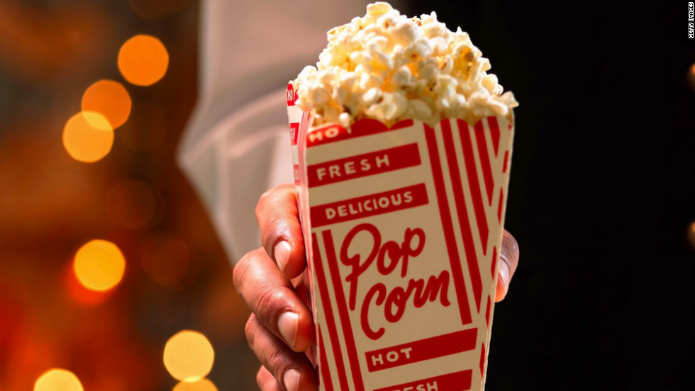 <strong>Best popcorn: Small with no toppings or real butter </strong><br />Choose the smallest size popcorn available, says Kriegler, and go easy on the salt and toppings. <br /><br />Even with a small, you'll likely want to split it with a friend. Regal, the country's largest theater chain, reports that their small popcorn contains 670 calories and 34 grams of saturated fat. AMC, the No. 2 chain, serves a smaller option: 370 calories, but still a day's worth of saturated fat (20 grams). <br /><br />Cinemark Theaters, the third largest chain, is your best bet when it comes to popcorn: Their kernels are popped in non-hydrogenated canola oil, which is much lower in saturated fat than its rivals' choice of coconut oil, and is offered in a Junior Bag for only 200 calories, 11 grams fat and only 1 gram saturated fat.