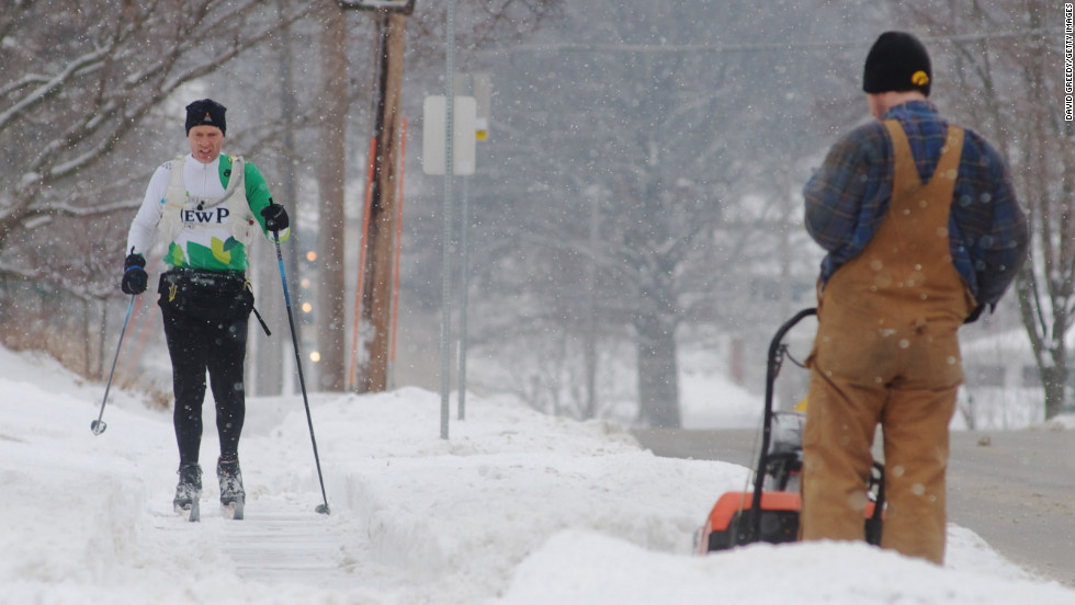 Shawn Noble skis to work after a winter storm left more than 6 inches of snow on February 22 in Iowa City, Iowa.