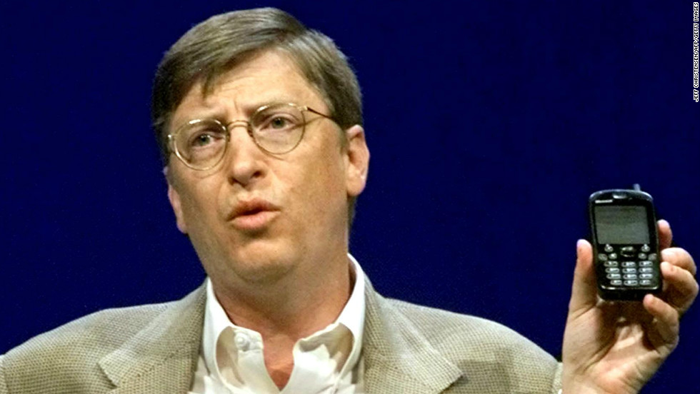 "Even Microsoft chairman Bill Gates was not immune from holding ugly phones. Here he makes a point with a ""new generation"" cellphone during his annual ""state of the industry"" speech at the COMDEX convention in Las Vegas in November 2000."
