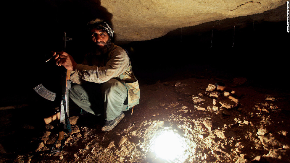 A Free Syrian Army member takes cover in underground caves in Sarmin on April 9, 2012.