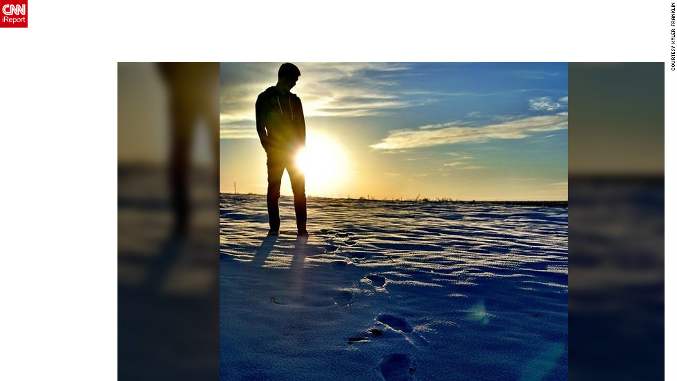 "<a href=""http://ireport.cnn.com/docs/DOC-932219"" target=""_blank"">Kyler Franklin</a> shares his photo of snow dusted footprints leading up to a reflective moment."