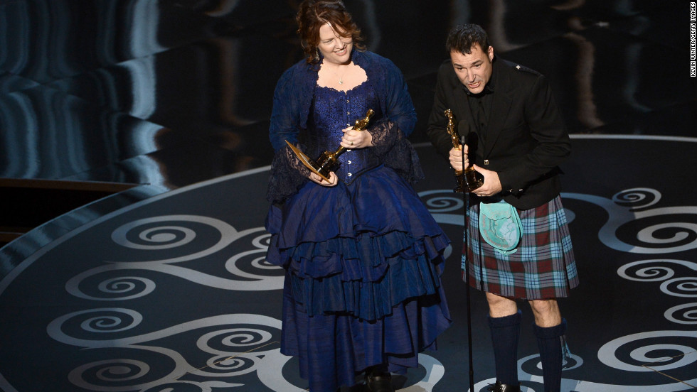 """Brave's"" Brenda Chapman and Mark Andrews accept the award for best animated feature film. Andrews wore a kilt in honor of the  Scottish Highlands-set film, while Chapman thanked her daughter for inspiring the story."