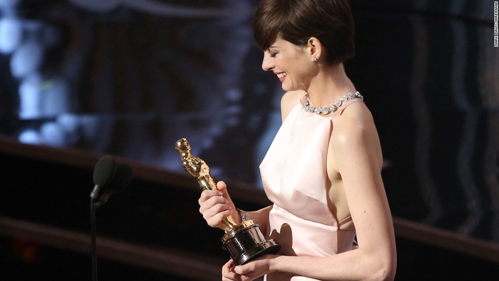 """Les Miserables"" actress Anne Hathaway accepts the award for best supporting actress."
