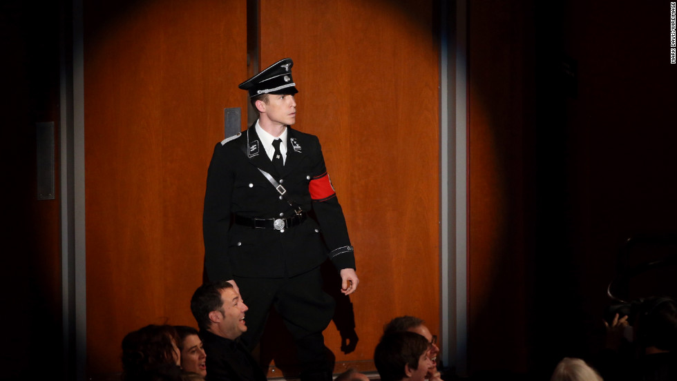 """MacFarlane tries to introduce the Von Trapp family from """"The Sound of Music,"""" but an actor dressed as a Nazi runs into the auditorium and announces they're gone. Laughter ensues."""