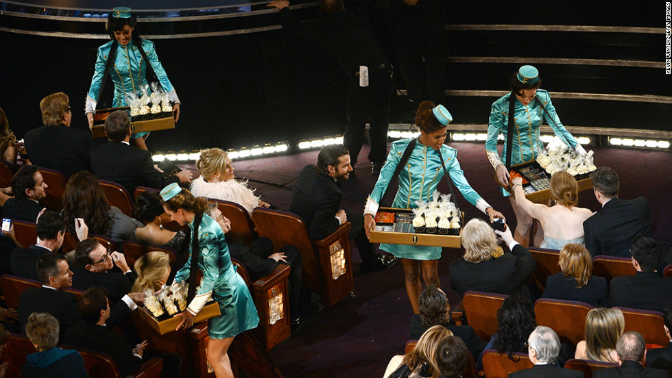 Hostesses hand out snacks during a break in the Oscars.