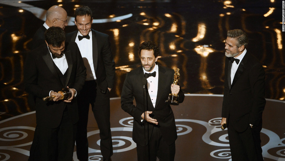 """""""Argo"""" producer Grant Heslov makes a joke about him, Ben Affleck and George Clooney being the three sexiest producers alive while accepting the award for best picture. Affleck eventually stepped up to the microphone to thank Canada, Iran and his wife Jennifer Garner, who he doesn't """"normally associate with Iran."""" """"I never thought I would be back here,"""" he said."""