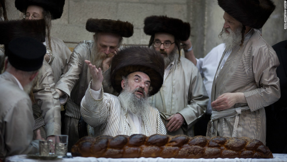 Ultra-Orthodox Jews from the Lelov Hasidic sect gather around their rabbi as they celebrate the Jewish festival of Purim in Beit Shemesh, Israel.