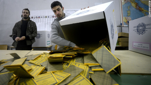Workers open the ballots in a polling station in downtown Romein a polling station in Rome on February 25, 2013.