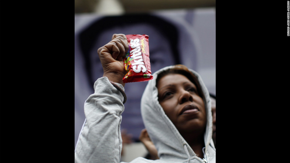 New York City Council Member Letitia James holds a package of Skittles candy while wearing a hoodie on the steps of City Hall in New York on March 28.