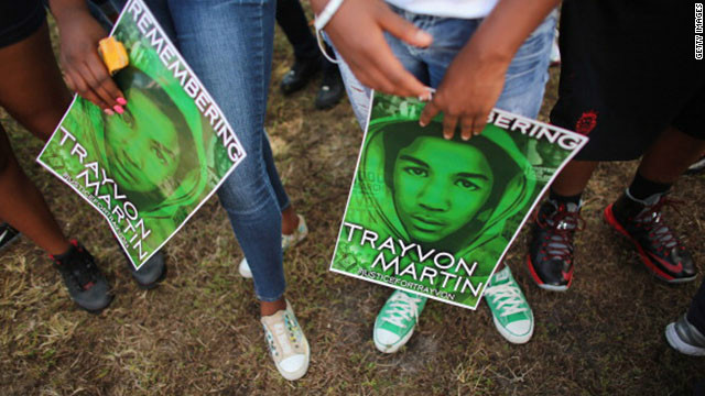 People stand together during a 'March for Peace' in honor of the late Trayvon Martin on February 9, 2013 in Miami. Martin was killed by George Zimmerman on February 26, 2012 while Zimmerman was on neighborhood watch patrol in a gated community in Sanford, Florida.