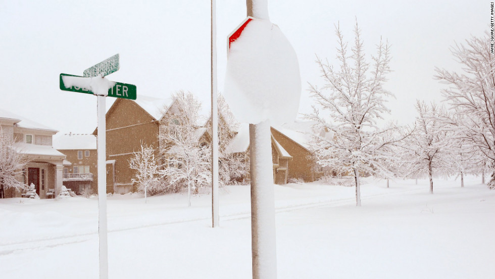 Heavy snow covers street signs in Kansas City, Missouri, on February 26.