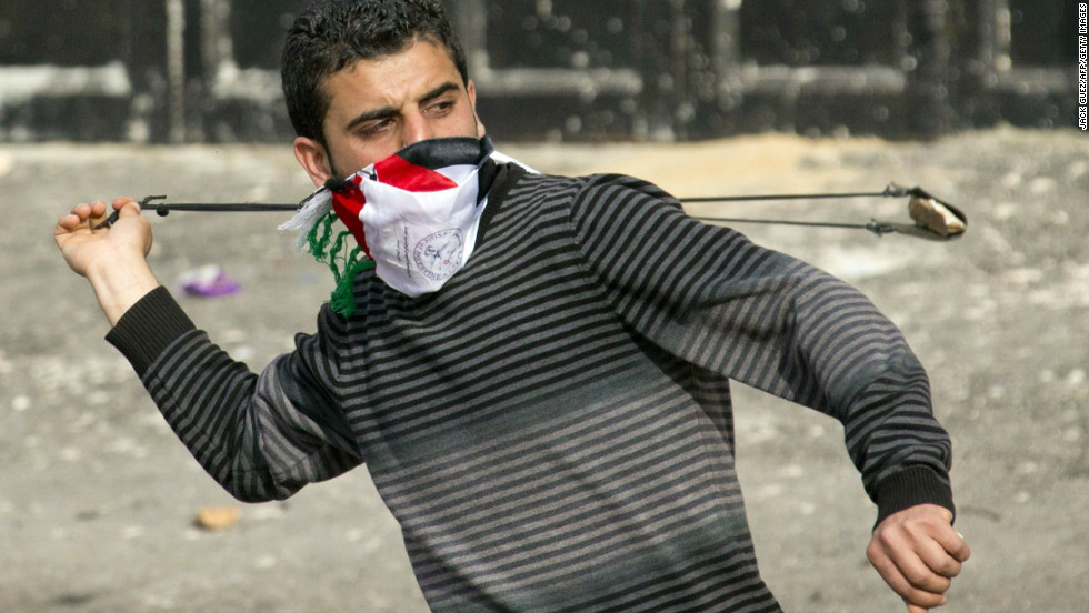 A Palestinian protestor uses a slingshot to throw stones towards Israeli security forces during clashes in the West Bank village of Saair on February 25, 2013 after the funeral of a Palestinian inmate who died in an Israeli prison.