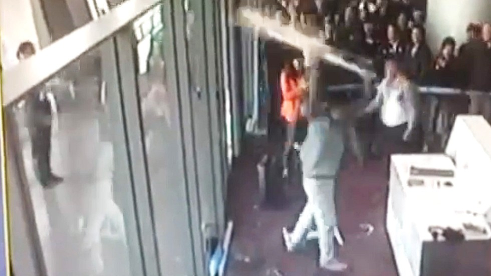 "This image is taken from a video showing a Chinese politician smashing equipment after he turned up late to his departure gate at a Chinese airport and was refused boarding. The video clip when viral. Such incidents need to be taken in context, given how many Chinese travelers there are in the world, Dr. Yong Chen says. ""Travel is a way of communication between cultures,"" he says. ""Tourism will help people to get better and learn. It's a new experience for them."""