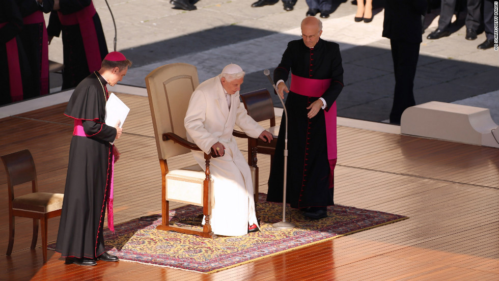 "Benedict takes his seat on the dias in St. Peter's Square. In an unusually personal message, he said there had been ""many days of sunshine"" but also ""times when the water was rough ... and the Lord seemed to sleep."""
