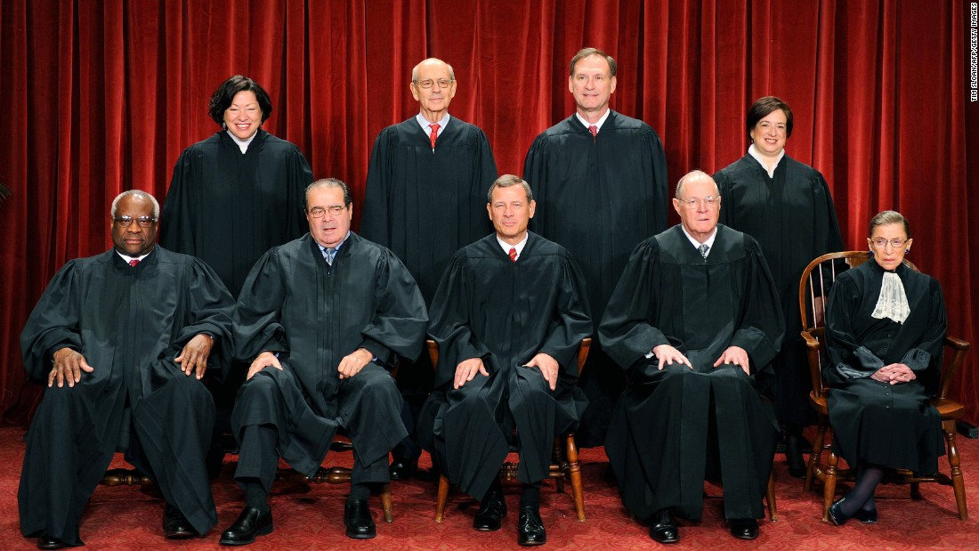 The justices of the U.S. Supreme Court sit for their official photograph on October 8, 2010, at the Supreme Court. Front row, from left: Clarence Thomas,  Antonin Scalia, Chief Justice John G. Roberts, Anthony M. Kennedy and Ruth Bader Ginsburg. Back row, from left: Sonia Sotomayor, Stephen Breyer, Samuel Alito Jr. and Elena Kagan. Scalia was found dead on February 13 at a Texas ranch he was visiting.
