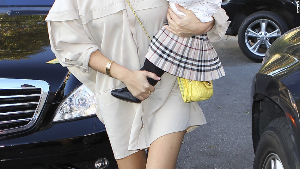 Kourtney Kardashian heads out with baby Penelope.