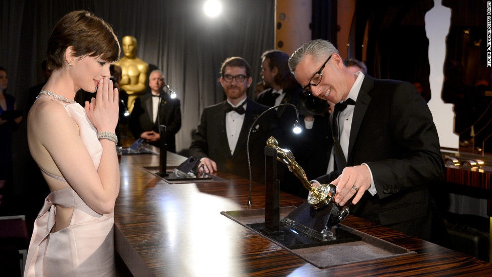 Hathaway gets her Oscar engraved at the Oscars Governors Ball on February 24.