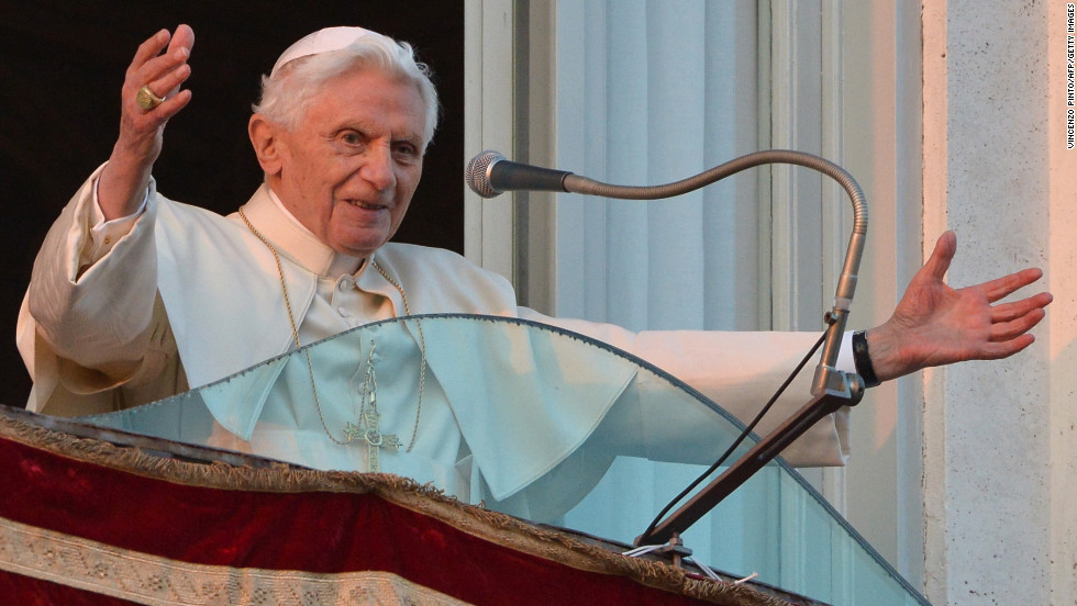 Pope Benedict XVI waves to the crowd from a balcony upon his arrival in Castel Gandolfo.