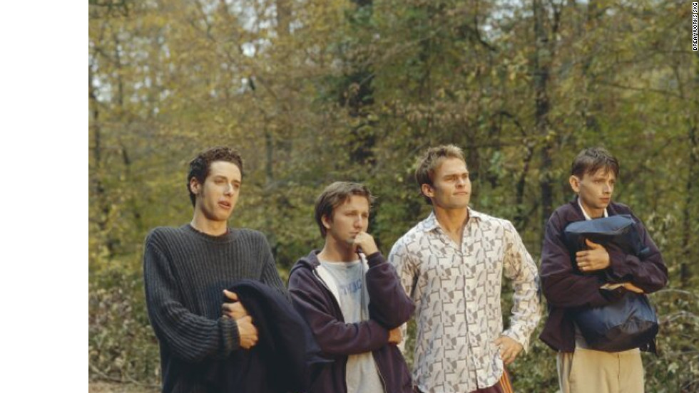 "When Breckin Meyer's Josh Parker, second from left, accidentally sends his long-distance girlfriend an incriminating tape, he and his buds drive across the country to retrieve it in Todd Phillips' ""Road Trip."" Paulo Costanzo, left, Seann William Scott, DJ Qualls and Tom Green, not pictured, also star."