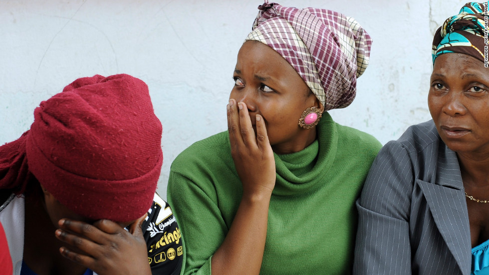 Relatives gather on March 1, 2013 outside the home of Mido Macia, the taxi driver who was allegedly dragged to death by South African police in Daveyton, east of Johannesburg.