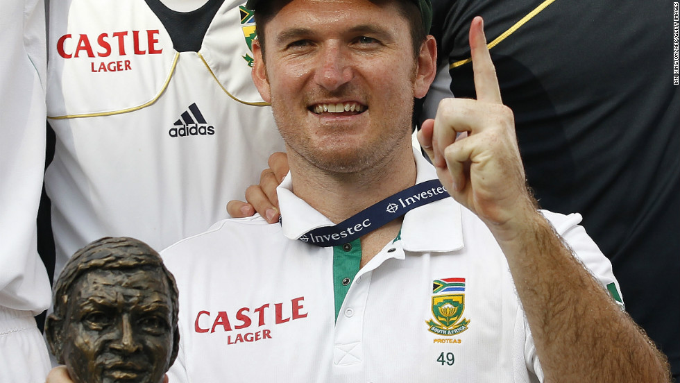 South Africa captain Graeme Smith celebrates with the Basil D'Oliveira trophy after taking the 2012 Test match series following victory over England.