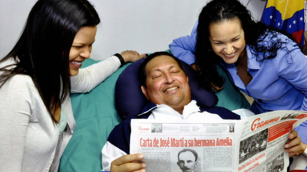 A handout picture released by the Venezuelan presidential press office on Friday, February 15, 2013, shows Chavez surrounded by his daughters and holding the February 14 edition of the official Cuban newspaper Granma at a hospital in Havana, Cuba.
