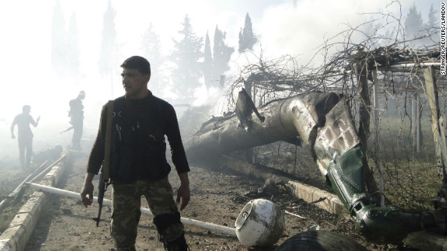 Members of the Free Syrian Army inspect the wreckage of a helicopter, belonging to forces loyal to Syrian President Bashar al-Assad in Aleppo on Saturday, March 2.