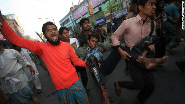 Bangladeshi Islamist activists carry a wounded protester after he was injured during clashes with police in Bogura some 120kms north of Dhaka on March 3, 2013. Bangladesh deployed troops in the north of the country after 16 more people were killed in a fresh wave of violence over the conviction of Islamist leaders for war crimes in the Muslim-majority nation. AFP PHOTO/STR (Photo credit should read STRDEL/AFP/Getty Images)