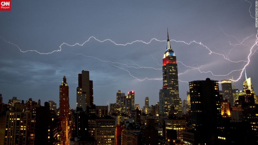 "<a href=""http://ireport.cnn.com/docs/DOC-821097"">Matthew Burke</a> shot this dramatic lightning strike from his Manhattan apartment window. ""The brunt of the storm itself was intense but short,"" he said. ""There was very strong rain and wind for about 15 minutes, at which point the rain cleared and the lightning show began."""