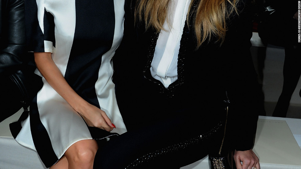Nicole Richie and Jessica Alba attend a fashion show in Paris, France.
