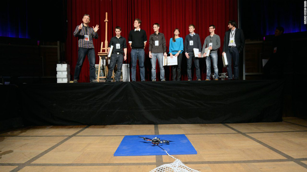 "D'Andrea advises a small group of grad students at ETH Zurich. Together they are creating ever more complex tasks for their fleet of quadrocopters. Here the group can be seen onstage during a presentation at a <a href=""http://zurichminds.com/"" target=""_blank"">Zurich Minds</a> event last year."