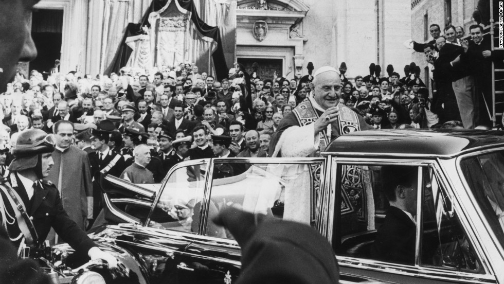 October 1962: Standing in an open Mercedes, Pope John XXIII receives an enthusiastic welcome from the crowds at Loreto.