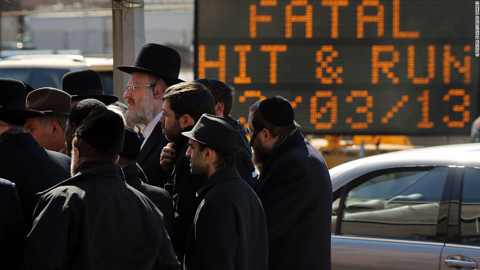 Members of the Brooklyn Orthodox Jewish community attend a news conference Monday, March 4, after an Orthodox couple died in a hit-and run-crash on Sunday. The day after the crash killed them, it claimed another life: their newborn son.