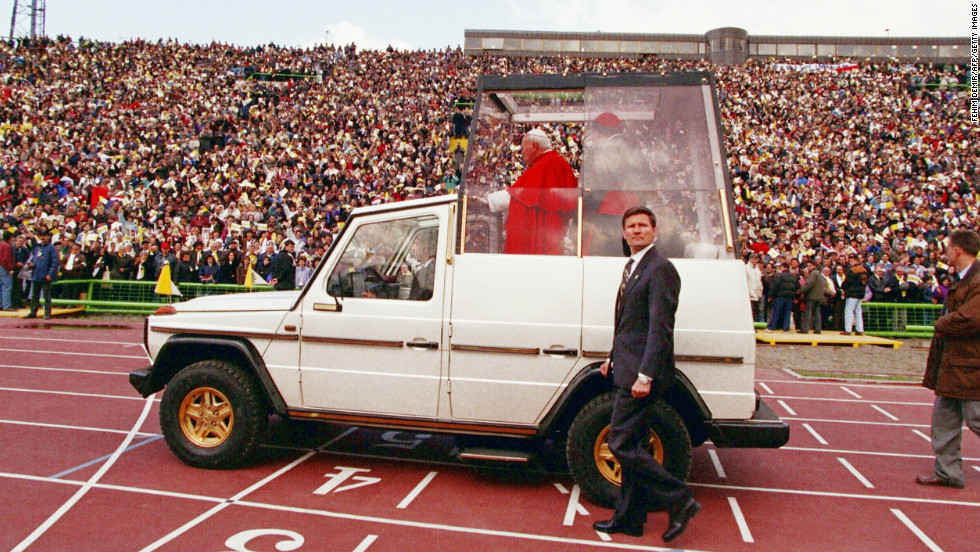 In this version of the Popemobile, Pope John Paul II arrives at Sarajevo stadium on April 13, 1997.