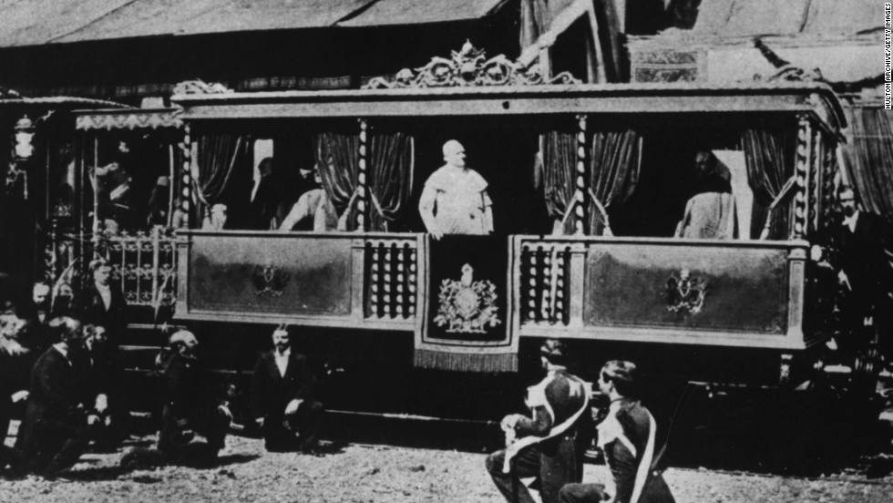 Pope Pius IX, Giovanni Mastai Ferretti stands in an open salon coach at a railway station in Rome in about 1846.