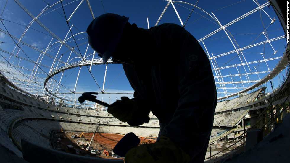 A worker swings a hammer inside 'Arena Fonte Nova' stadium in Salvador de Bahia, Brazil on December 6, 2012 before next June's eight-nation Confederations Cup.