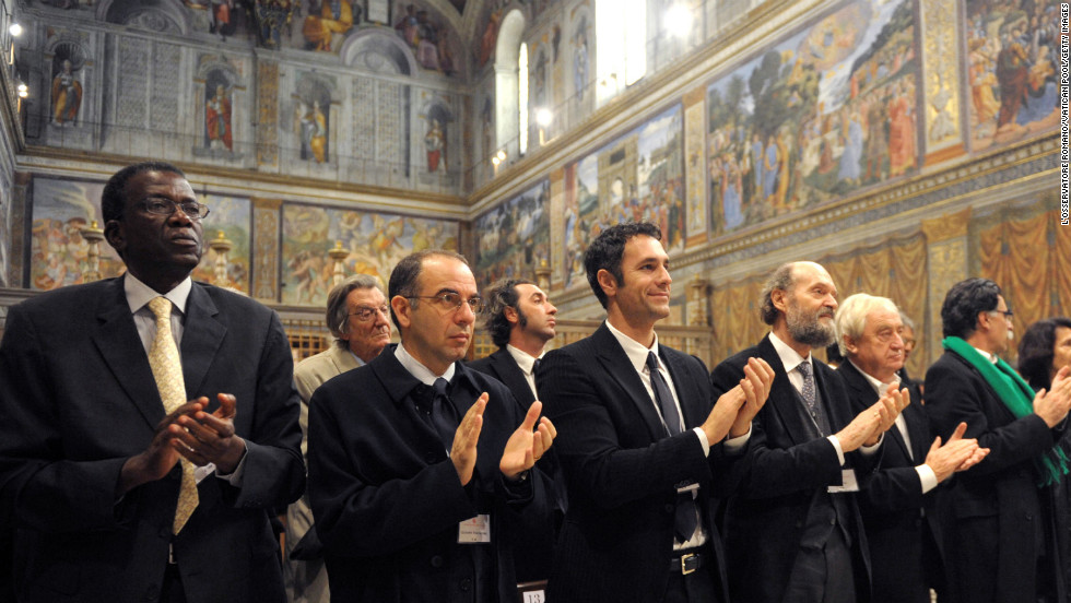 Artists applaud at the end of a meeting with Pope Benedict XVI at the Sistine Chapel on November 21, 2009. About 250 artists accepted an invitation to discuss renewing the alliance of art and the church while encouraging the artists to infuse spirituality into their works.
