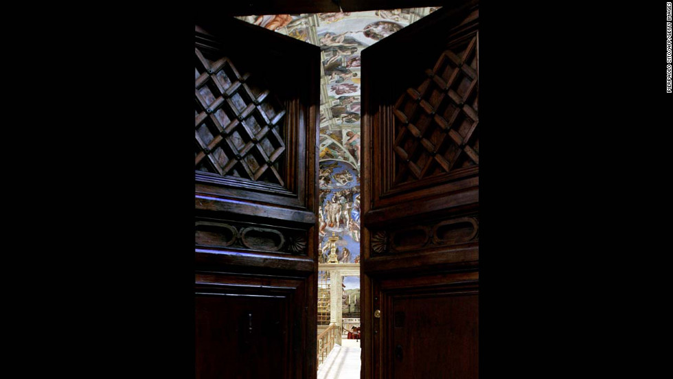 "Michelangelo's ""The Last Judgment"" is seen through the Sistine Chapel doors on April 16, 2005."