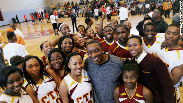 Isiah Thomas poses with some of the young people at a Peace Tournament, which gave rise to Windy City Hoops.