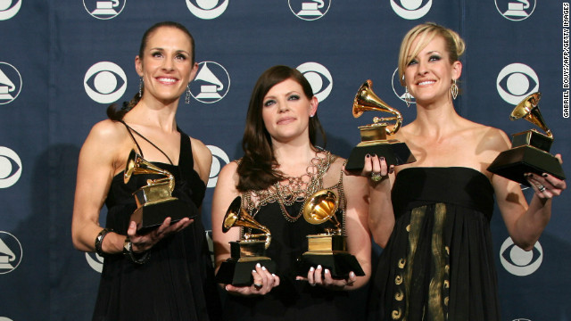 Los Angeles, UNITED STATES: Winners of Best Record of the Year, Best Album of the Year, Best Song of the Year, Best Country Performance By A Duo Or Group With Vocal and Best Country Album, the Dixie Chicks, Emily Robison (L), Natalie Maines (M) and Martie Maguire (R) pose with the trophies at the 49th Grammy Awards in Los Angeles 11 February 2007. The outspoken country trio the Dixie Chicks swept the 49th Grammy awards with their hit single 'Not Ready To Make Nice,' a song that tackles their vocal criticism of US President George W. Bush. AFP PHOTO/Gabriel BOUYS (Photo credit should read GABRIEL BOUYS/AFP/Getty Images)