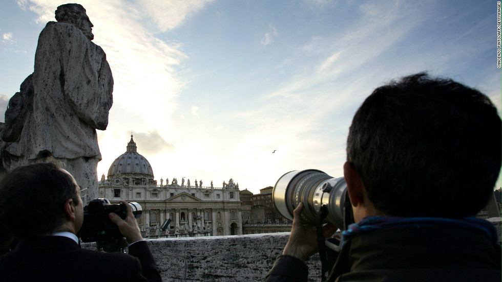The last conclave was in 2005, when Benedict's XIV was announced as pope.  Here photographers watch the chimney for smoke- black for failure and white for success on April 18, 2005.