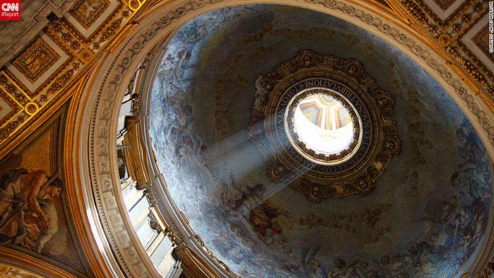 Sunlight shines through the dome of St. Peter's Basilica in Vatican City. When Michelangelo was chief architect of the church, he conceptualized the dome. It was only completed to the base when he died, but it was later finished.